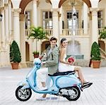 Couple sitting on a moped,Biltmore Hotel,Coral Gables,Florida,USA                                                                                                                                        Stock Photo - Premium Rights-Managed, Artist: Glowimages               , Code: 837-03071555