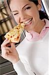 Female chef eating a slice of pizza                                                                                                                                                                      Stock Photo - Premium Rights-Managed, Artist: Glowimages               , Code: 837-03071570