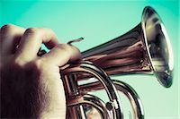 Close-up of a man blowing a bugle                                                                                                                                                                        Stock Photo - Premium Rights-Managednull, Code: 837-03072013