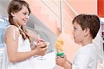 Boy and his sister holding ice creams                                                                                                                                                                    Stock Photo - Premium Rights-Managed, Artist: Glowimages               , Code: 837-03072197