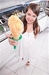 Portrait of a girl holding an ice cream                                                                                                                                                                  Stock Photo - Premium Rights-Managed, Artist: Glowimages               , Code: 837-03072199