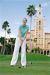 Golfer playing golf in a golf course and smiling,Biltmore Golf Course,Biltmore Hotel,Coral Gables,Florida,USA                                                                                            Stock Photo - Premium Rights-Managed, Artist: Glowimages               , Code: 837-03072275