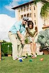 Couple playing croquet in a hotel lawn,Biltmore Hotel,Coral Gables,Florida,USA                                                                                                                           Stock Photo - Premium Rights-Managed, Artist: Glowimages               , Code: 837-03072329