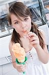 Girl eating an ice cream                                                                                                                                                                                 Stock Photo - Premium Rights-Managed, Artist: Glowimages               , Code: 837-03072409