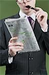 Close-up of a businessman marking on a newspaper                                                                                                                                                         Stock Photo - Premium Rights-Managed, Artist: Glowimages               , Code: 837-03072449