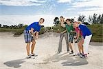 Five friends having fun in a golf course,Biltmore Golf Course,Coral Gables,Florida,USA                                                                                                                   Stock Photo - Premium Rights-Managed, Artist: Glowimages               , Code: 837-03072567