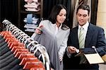 Saleswoman assisting a businessman in a clothing store                                                                                                                                                   Stock Photo - Premium Rights-Managed, Artist: Glowimages               , Code: 837-03072871