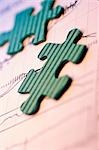 Close-up of two jigsaw pieces on a document                                                                                                                                                              Stock Photo - Premium Rights-Managed, Artist: Glowimages               , Code: 837-03072964