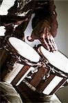 Close-up of a man playing a bongo                                                                                                                                                                        Stock Photo - Premium Rights-Managed, Artist: Glowimages               , Code: 837-03073169