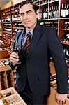 Businessman holding a wine glass                                                                                                                                                                         Stock Photo - Premium Rights-Managed, Artist: Glowimages               , Code: 837-03073211