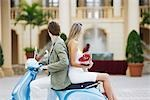 Couple sitting on a moped,Biltmore Hotel,Coral Gables,Florida,USA                                                                                                                                        Stock Photo - Premium Rights-Managed, Artist: Glowimages               , Code: 837-03073232
