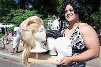 Close-up of a gay man holding a mannequin's heads,DuPont Circle,Washington DC,USA                                                                                                                        Stock Photo - Premium Rights-Managednull, Code: 837-03073298