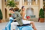 Couple sitting on a moped,Biltmore Hotel,Coral Gables,Florida,USA                                                                                                                                        Stock Photo - Premium Rights-Managed, Artist: Glowimages               , Code: 837-03073329