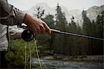 Man holding a fishing rod                                                                                                                                                                                Stock Photo - Premium Rights-Managed, Artist: Glowimages               , Code: 837-03073335