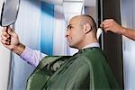 Barber using a brush on a man's neck                                                                                                                                                                     Stock Photo - Premium Rights-Managed, Artist: Glowimages               , Code: 837-03073436