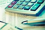 Calculator and a pen on a financial newspaper                                                                                                                                                            Stock Photo - Premium Rights-Managed, Artist: Glowimages               , Code: 837-03073650