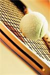 Close-up of a tennis ball and a tennis racket                                                                                                                                                            Stock Photo - Premium Rights-Managed, Artist: Glowimages               , Code: 837-03073903