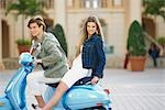 Couple sitting on a moped,Biltmore Hotel,Coral Gables,Florida,USA                                                                                                                                        Stock Photo - Premium Rights-Managed, Artist: Glowimages               , Code: 837-03073925