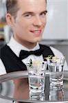 Waiter holding a tray of tequila shots                                                                                                                                                                   Stock Photo - Premium Rights-Managed, Artist: Glowimages               , Code: 837-03073957