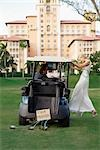 Newlywed couple in a golf cart,Biltmore Golf Course,Biltmore Hotel,Coral Gables,Florida,USA                                                                                                              Stock Photo - Premium Rights-Managed, Artist: Glowimages               , Code: 837-03074023