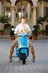 Man adjusting his tie and sitting on a moped,Biltmore Hotel,Coral Gables,Florida,USA                                                                                                                     Stock Photo - Premium Rights-Managed, Artist: Glowimages               , Code: 837-03074032