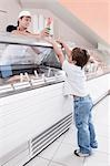 Sales clerk giving ice cream to a boy in an ice cream parlor                                                                                                                                             Stock Photo - Premium Rights-Managed, Artist: Glowimages               , Code: 837-03074164