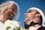 Low angle view of a newlywed gay couple,DuPont Circle,Washington DC,USA                                                                                                                                  Stock Photo - Premium Rights-Managed, Artist: Glowimages               , Code: 837-03074167