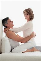 Couple romancing in the bedroom                                                                                                                                                                          Stock Photo - Premium Rights-Managednull, Code: 837-03074174