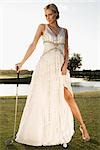 Bride standing in a golf course,Biltmore Golf Course,Coral Gables,Florida,USA                                                                                                                            Stock Photo - Premium Rights-Managed, Artist: Glowimages               , Code: 837-03074435