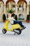 Man reclining on a moped in front of a hotel building,Biltmore Hotel,Coral Gables,Florida,USA                                                                                                            Stock Photo - Premium Rights-Managed, Artist: Glowimages               , Code: 837-03074468