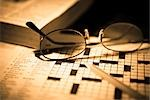 Close-up of a pencil and eyeglasses on a crossword puzzle                                                                                                                                                Stock Photo - Premium Rights-Managed, Artist: Glowimages               , Code: 837-03074471