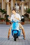 Man looking into a moped mirror,Biltmore Hotel,Coral Gables,Florida,USA                                                                                                                                  Stock Photo - Premium Rights-Managed, Artist: Glowimages               , Code: 837-03074561