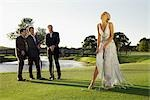 Bride playing golf and three men watching her,Biltmore Golf Course,Coral Gables,Florida,USA                                                                                                              Stock Photo - Premium Rights-Managed, Artist: Glowimages               , Code: 837-03074621