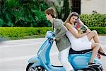 Couple sitting on a moped,Biltmore Hotel,Coral Gables,Florida,USA                                                                                                                                        Stock Photo - Premium Rights-Managed, Artist: Glowimages               , Code: 837-03074681