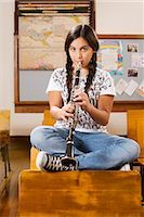 Schoolgirl playing a clarinet in a classroom                                                                                                                                                             Stock Photo - Premium Rights-Managednull, Code: 837-03074735