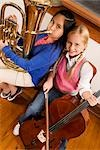 Portrait of two girls playing violin and tuba in a class                                                                                                                                                 Stock Photo - Premium Rights-Managed, Artist: Glowimages               , Code: 837-03075053