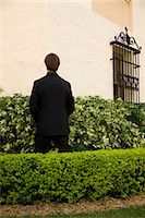 Businessman urinating in a formal garden,Biltmore Hotel,Coral Gables,Florida,USA                                                                                                                         Stock Photo - Premium Rights-Managednull, Code: 837-03075070