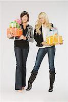female white background full body - Two Women Holding Gifts Stock Photo - Premium Royalty-Freenull, Code: 600-03075110