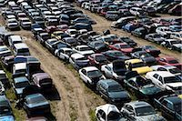 Old Cars Lined-up in Auto Wrecking Yard Stock Photo - Premium Royalty-Freenull, Code: 600-03075815