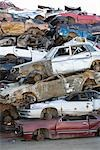 Old Cars Stacked up in Auto Wreckage Yard