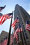 American Flags at Rockefeller Center, GE Building in the Background, NYC, New York, USA Stock Photo - Premium Royalty-Free, Artist: Pierre Arsenault         , Code: 600-03075823