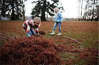 pile leaves playing - Girls Playing Outdoors                                                                                                                                                                                   Stock Photo - Premium Rights-Managednull, Code: 700-03075882