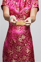 singapore traditional costume lady - cropped shot of woman in pink cheongsam Stock Photo - Premium Royalty-Freenull, Code: 656-03076254