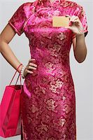 singapore traditional costume lady - cropped shot of woman holding a credit card and shopping bag. Stock Photo - Premium Royalty-Freenull, Code: 656-03076279