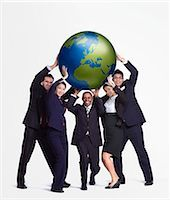 A business group holding up a big globe Stock Photo - Premium Royalty-Freenull, Code: 649-03077993