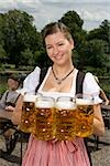 A traditionally clothed German woman serving beer in a beer garden Stock Photo - Premium Royalty-Free, Artist: Bettina Salomon, Code: 653-03079657