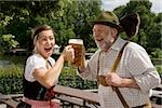 A traditionally clothed German man and woman in a beer garden toasting glasses Stock Photo - Premium Royalty-Free, Artist: Beyond Fotomedia, Code: 653-03079668