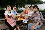 Five people sitting in a beer garden Stock Photo - Premium Royalty-Free, Artist: Cultura RM, Code: 653-03079671