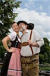 A traditionally clothed German man and woman in a beer garden Stock Photo - Premium Royalty-Free, Artist: Beyond Fotomedia, Code: 653-03079674