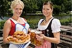 Two traditionally clothed German women serving pretzels and beer in a beer garden Stock Photo - Premium Royalty-Free, Artist: Beyond Fotomedia, Code: 653-03079680